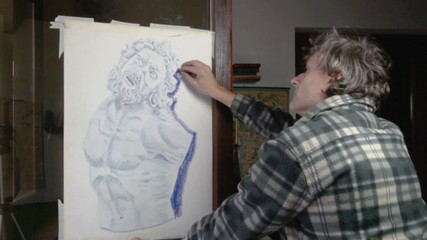 artist making a pencil drawing