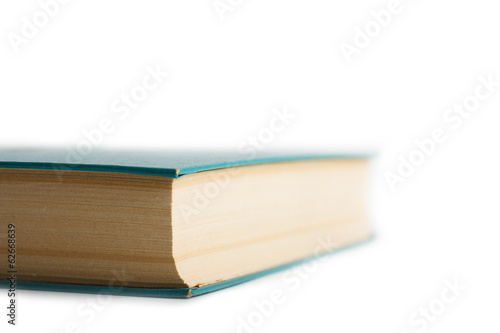 Isolated closed book with a few bookmarks