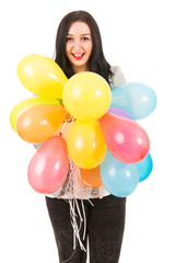 Happy woman holding many balloons
