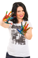 Smiling woman showing painted hands