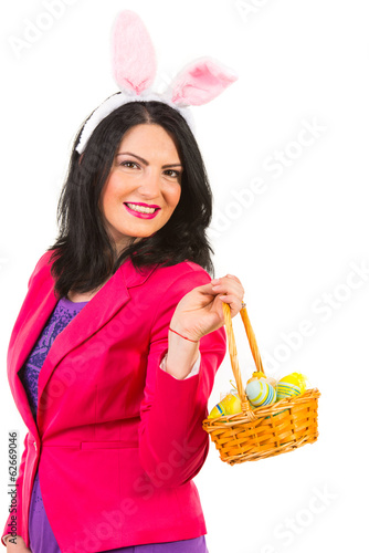 Beautiful woman with bunny ears holding basket