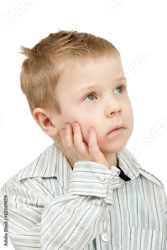 Studio portrait of young pensive beautiful boy