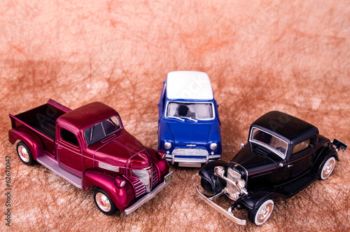 Vintage toy cars in an old background