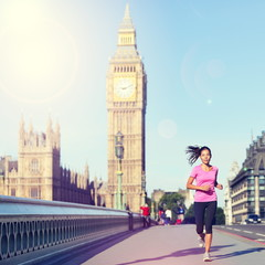 London woman running Big Ben - England lifestyle
