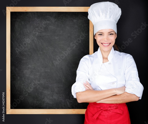 Chef showing menu blackboard