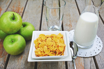 corn cereal with fresh milk and green apples