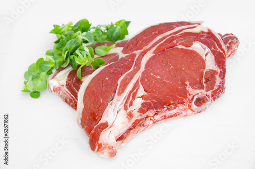 Pieces of crude meat, beef steak on white. Isolated