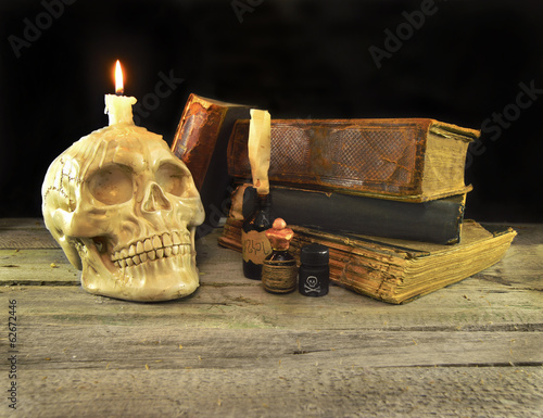 Human skull with books