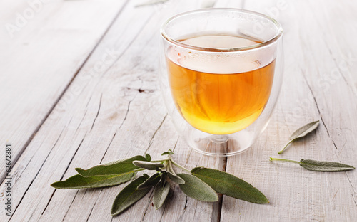 Herbal sage tea on wooden background