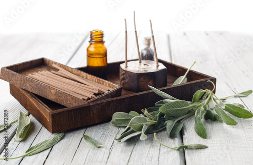 Fresh sage leaves with spa aromatherapy kit