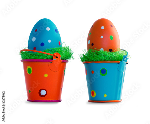 Easter eggs in buckets isolated on white background