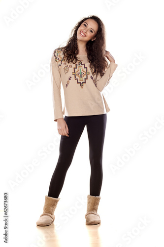 pretty smiling girl standing on white background
