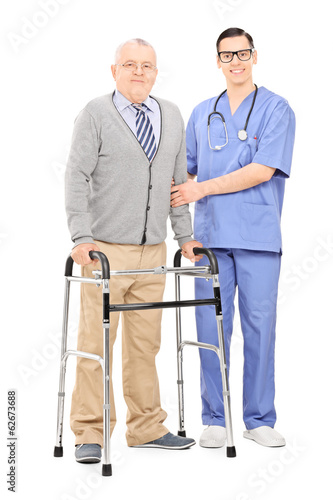 Senior gentleman with walker posing next to doctor
