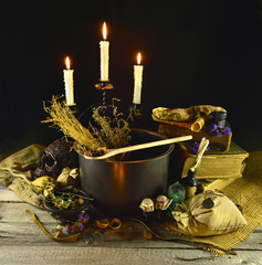 Halloween cauldron with candles