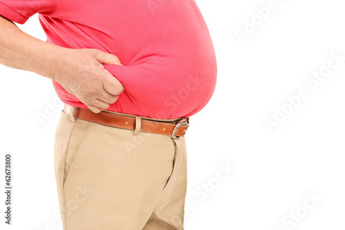 Studio shot of a man with big belly