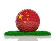 Golf ball with flag of China on green grass