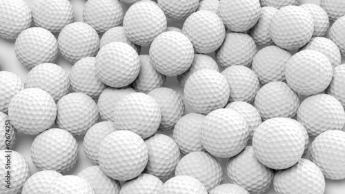 Many golf balls together closeup isolated on white - 62674251