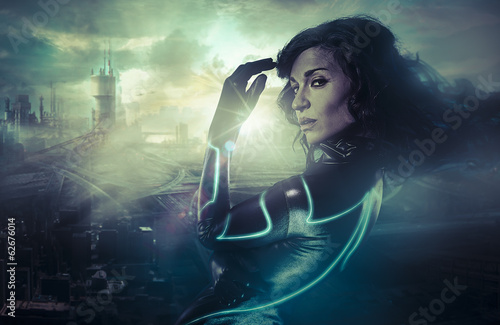 Future woman concept, black latex with neon lights over city ​