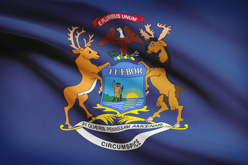 Series of ruffled flags. State of Michigan flag.