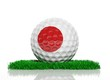 Golf ball with flag of Japan on green grass
