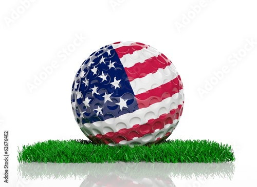 canvas print picture Golf ball with flag of USA on green grass