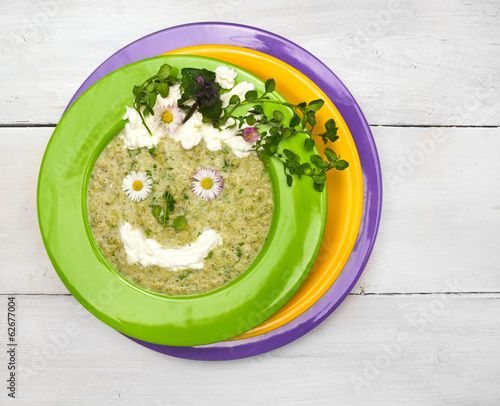 spring green soup with wild herbs,decorations smile face