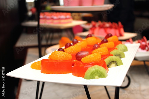 Fruit jelly with and orang kiwi on white plate