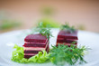 appetizer of beet and cheese on lettuce leaves