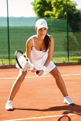 Focused tennis player on tennis court