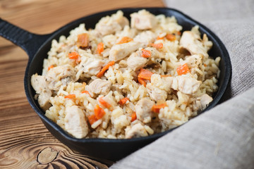 Pilaf with chicken, close-up, horizontal shot