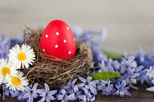 Red Easter egg in a nest