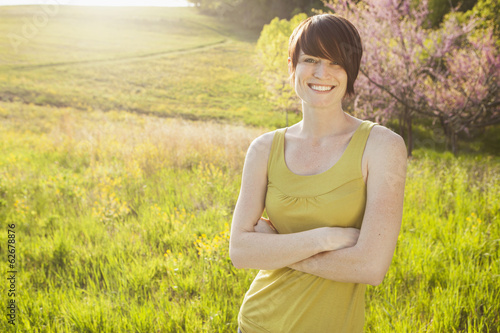 Young Woman In Grassy Field In Spring.