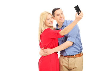 Young couple taking selfie with cell phone