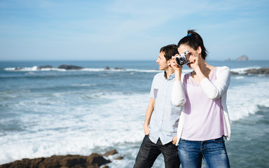 Couple on travel taking photo to beautiful seascape