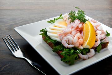 Delicious shrimp salad sandwich on a plate