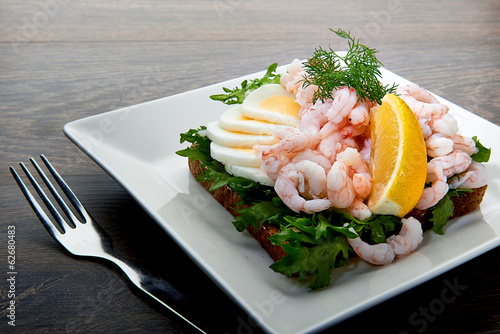 Delicious shrimp salad sandwich on a plate