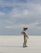 A Man Wearing A Horse Mask, Standing On The Bonneville Salt Flats.