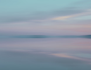 Shallow Water Over The Surface At The Bonneville Salt Flats At Dusk.