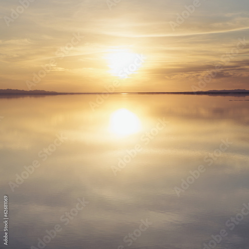 Shallow Water Over The Surface At The Bonneville Salt Flats, At Sunset.