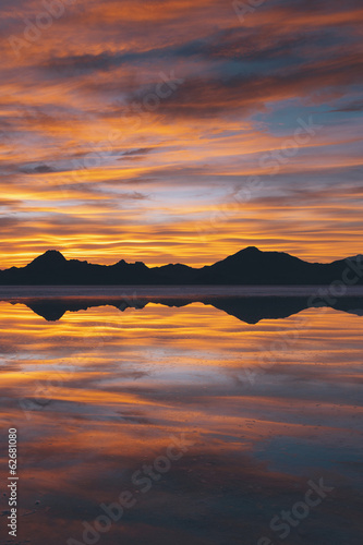 The Sky At Sunset. Layers Of Cloud Reflecting In The Shallow Waters Flooding The Bonneville Salt Flats