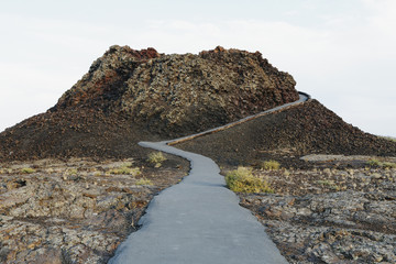 A Paved Pathway Up Into The Lava Fields Of The Craters Of The Moon National Monument And Preserve In Butte County Idaho.