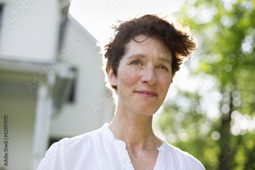 Organic Farm. Summer Party. A Mature Woman Smiling.