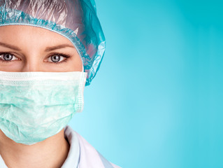 Close-up of female surgeon face with space for text