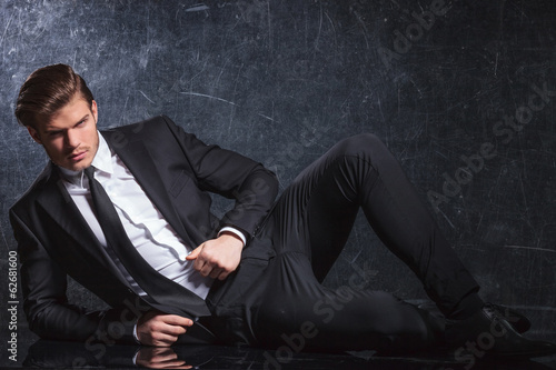 sexy young fashion man lying down