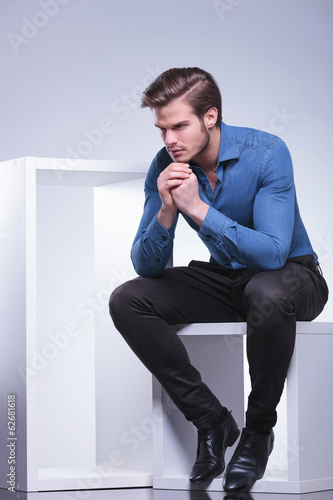 side view of a pensive young casual man