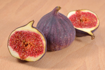 Fresh figs on wooden board