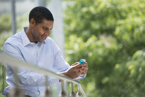 Summer. Business People. A Man Checking His Smart Phone For Messages.