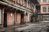 Old industrial street view with red brick facades and tubes - 62682494