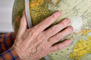 Globe in old man's hands