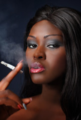 .Young woman of African smoking